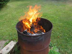 BURN PAPERS IN A DRUM BARREL